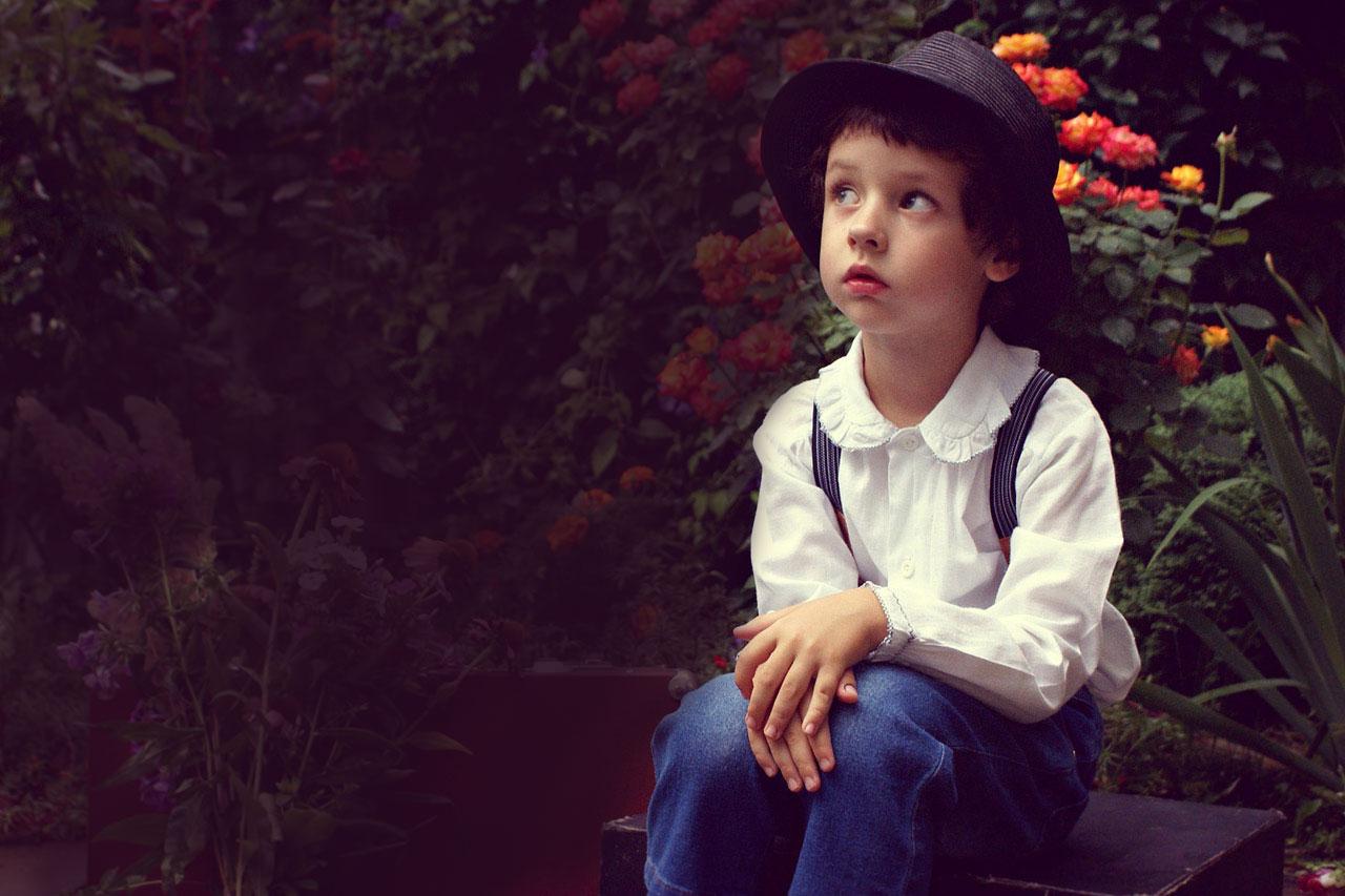 Boy Hat Sitting Garden