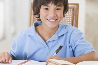 boy in blue shirt studying in Toronto, Ontario