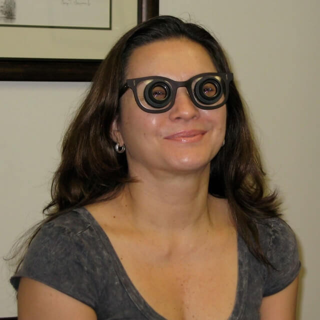 happy woman wearing low vision glasses