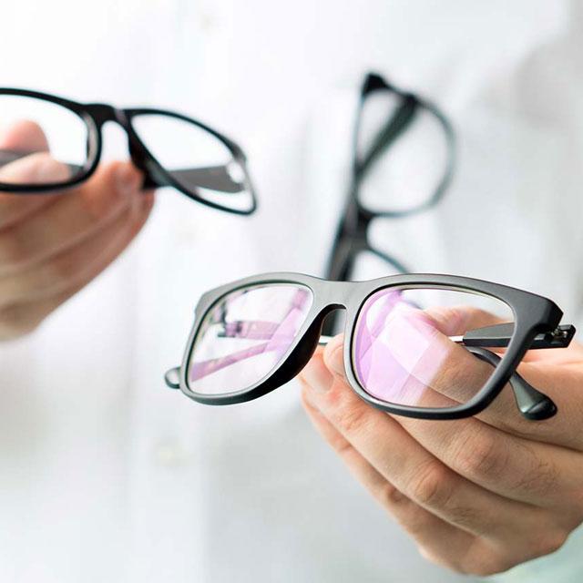 Optician Holding Glasses