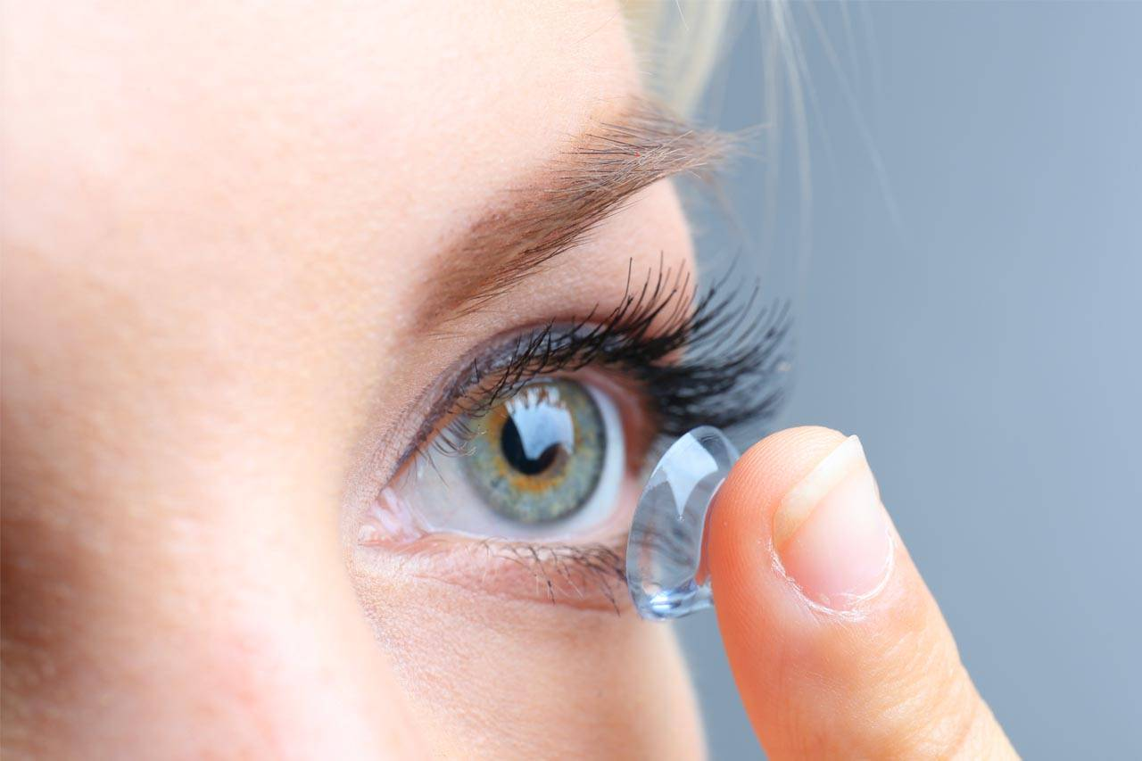 Woman Inserting Scleral Contact Lenses in Markham ON