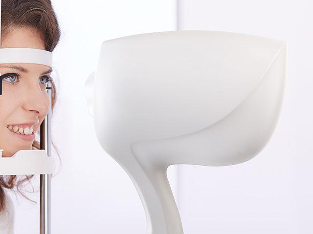 Eye Care, Woman getting eye exam in , California