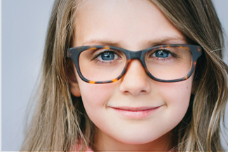 girl with glasses for vision correction