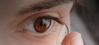 Eye doctor, african american woman wearing toric contact lenses in Redondo Beach, CA