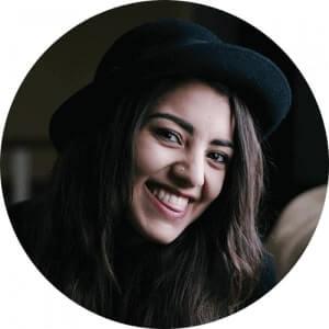smile woman dark hat