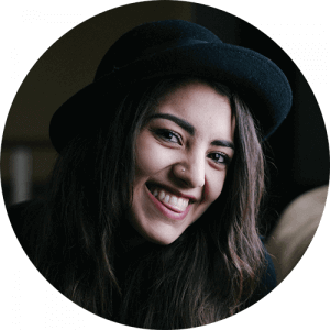 smile woman dark hat bkgnd 300×300