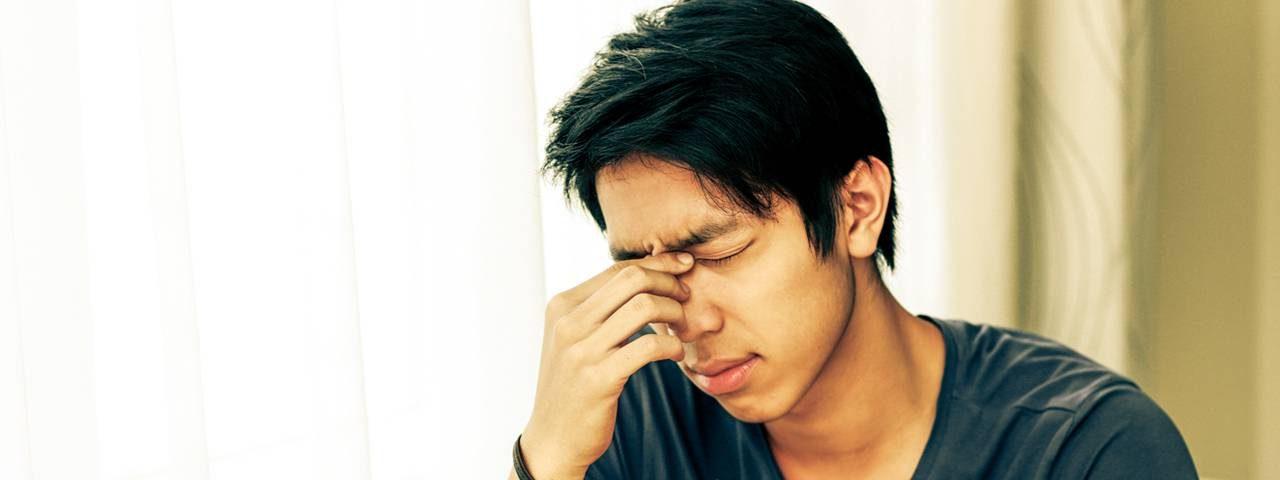 Eye doctor, asian man suffering from dry eyes in San Antonio, TX