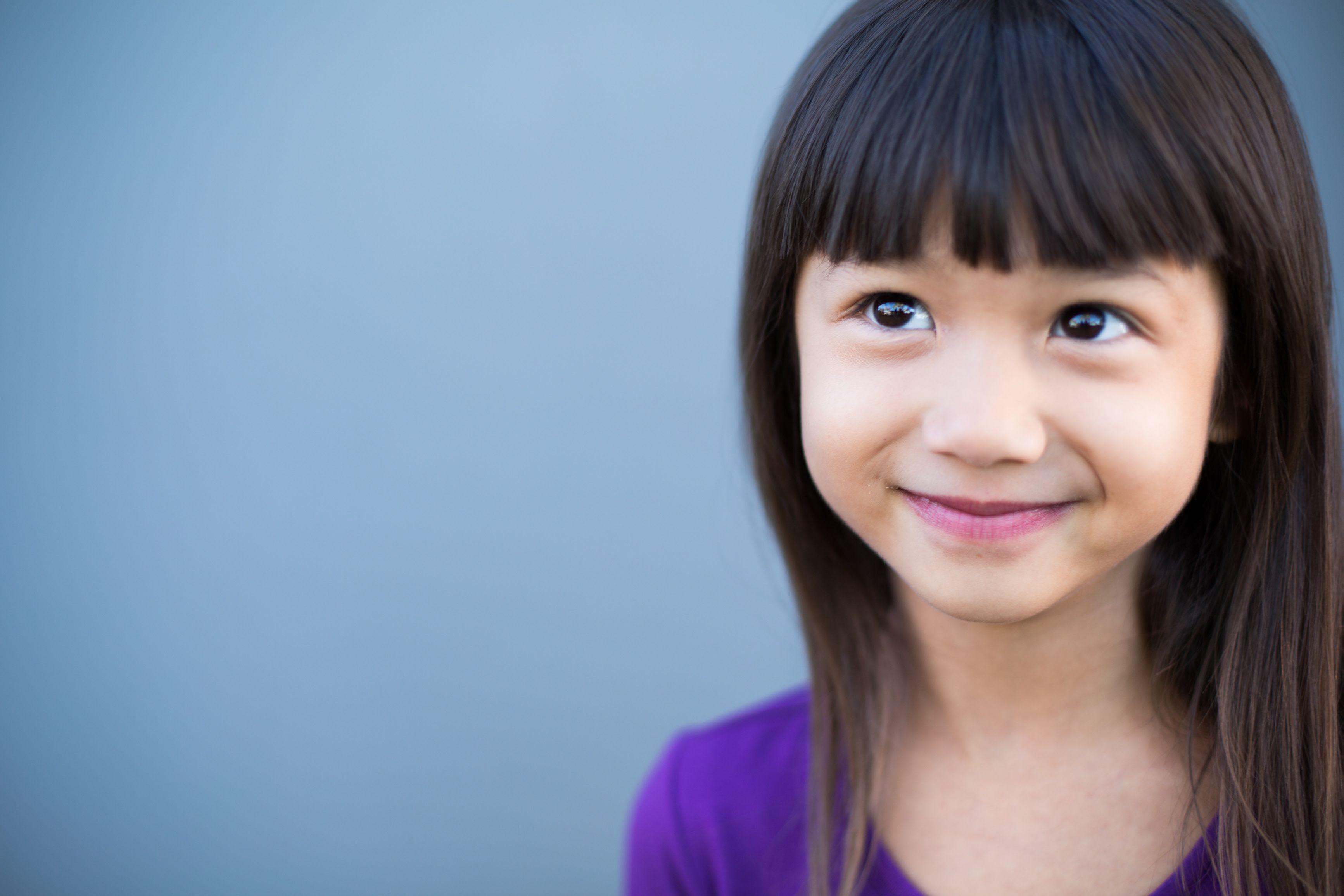 Young girl in purple shirt