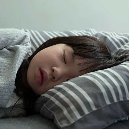 Asian Child Girl Sleeping On The Bed In Her Bedroom