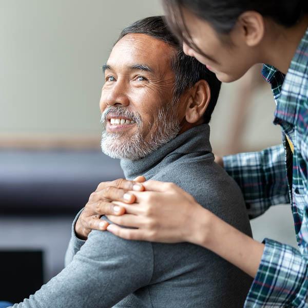 Smiling Happy Older Asian Father With Stylish Short Beard Touchi
