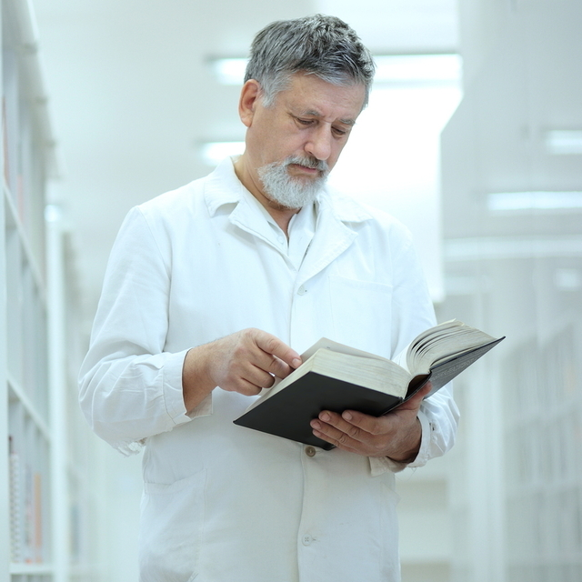 Renowned scientist/doctor in a library of research center/hospit