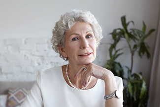senior woman with pearls visio 325