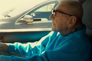 senior man driving with lv 325