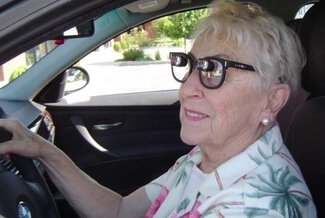 senior woman driving with low vision 325