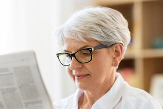 senior woman reading 325