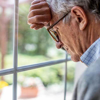 Depressed senior man in isolation at home for virus outbreak