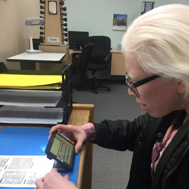albinism patient using low vision devices