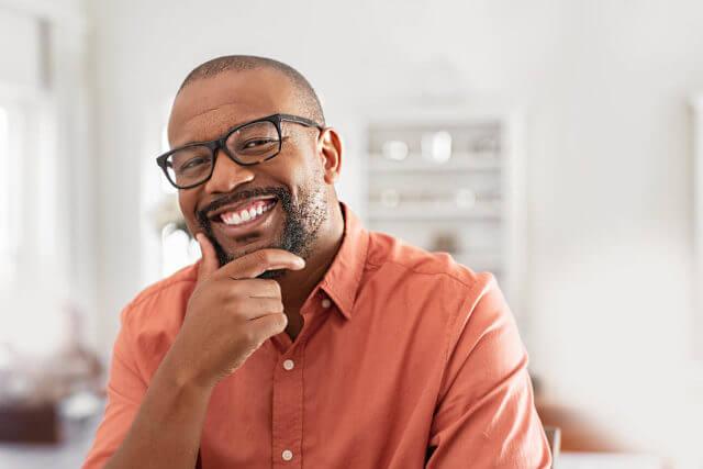 Cheerful black man glasses 1 640x427