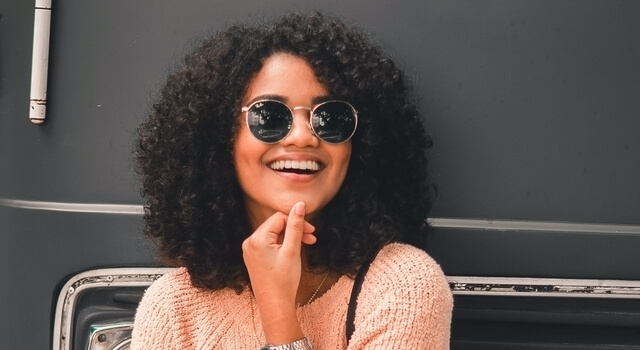 woman wearing sunglasses smiling 640
