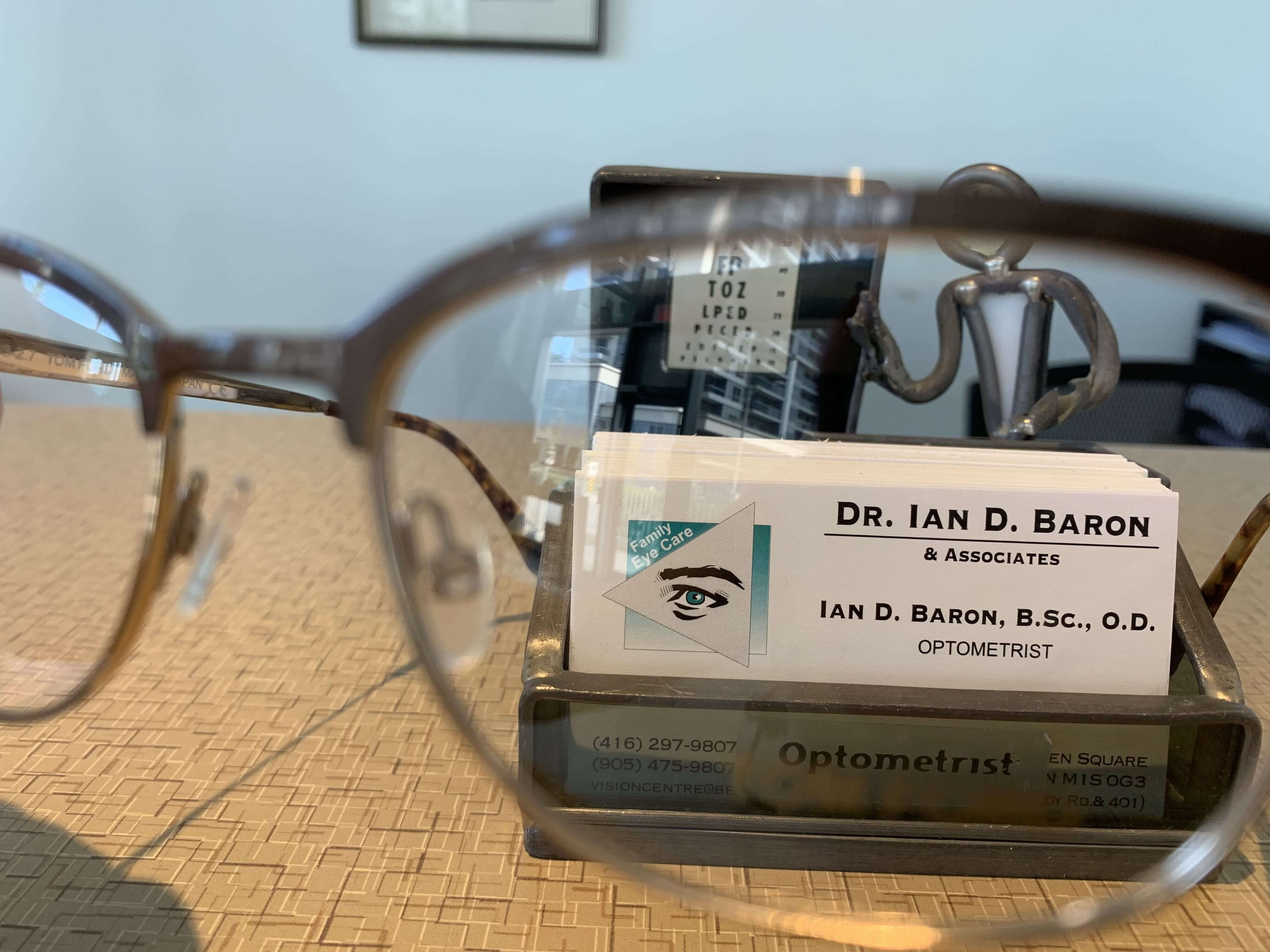 Dr. Ian D. Baron Business card, with eyeglasses in back