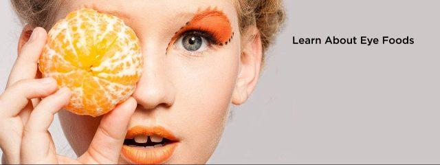 Eye doctor, woman holding an orange over her eye in Lee's Summit and Lenexa