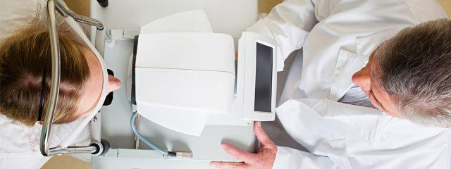 Eye doctor, woman at a contact lens eye exam in Lenexa, Kansas
