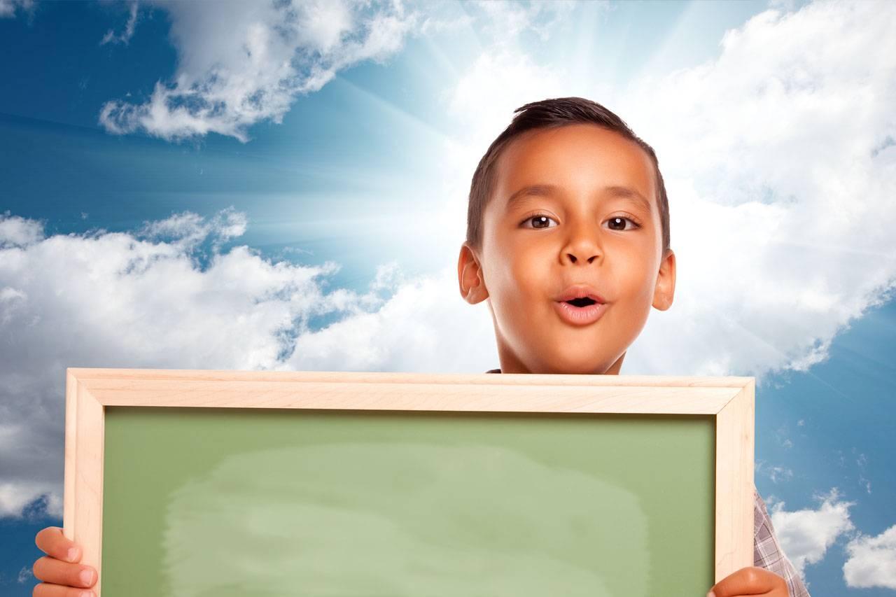 boy chalkboard ooohing hispanic 1280×853