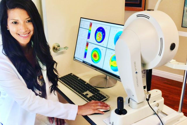 Dr. Ming looking at camera