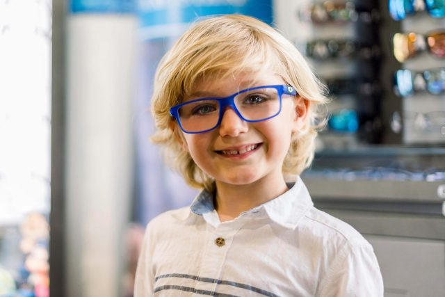 boy with blue glasses
