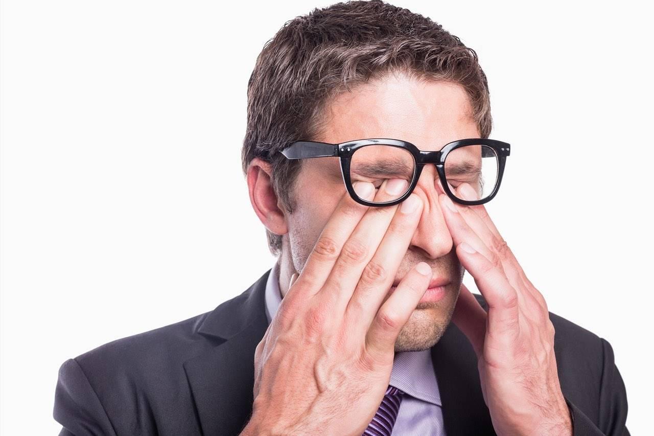 eye rub businessman 1280×853