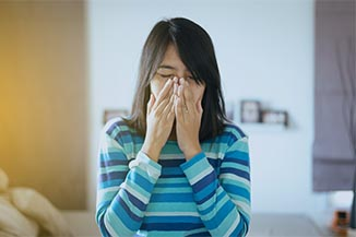 Woman With Allergy Symptoms