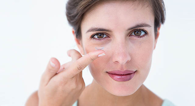 Woman holding contact lens on her finger in Commerce City, Colorado