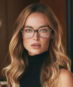 Woman wearing Oliver Peoples Eyewear