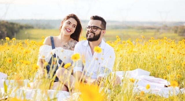 couple-on-a-field-of-flowers