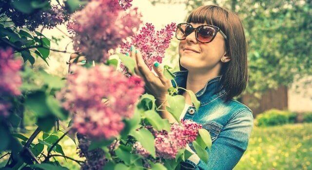 woman-admiring-flowers-640