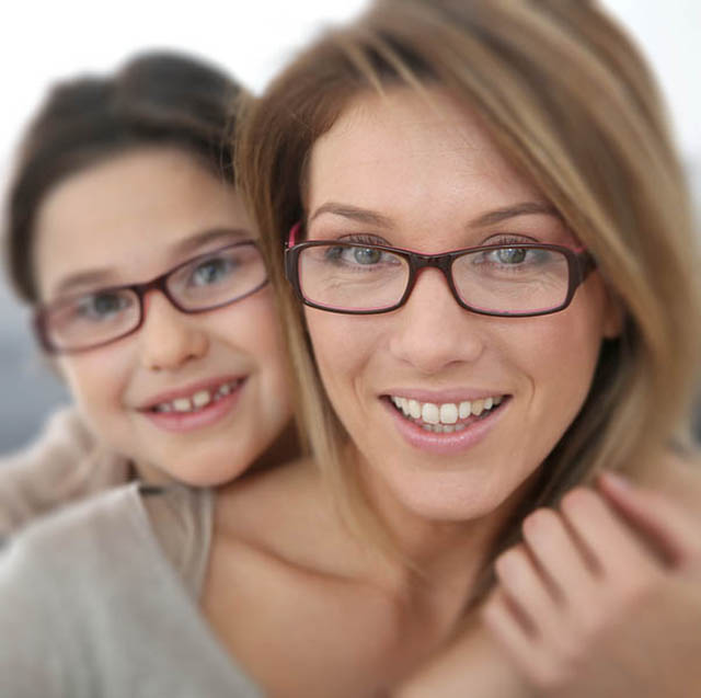 portrait of mother and daughter wearing eyeglasses