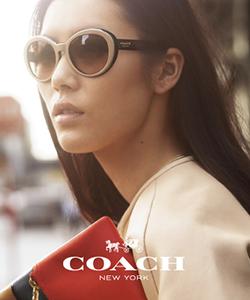 Model wearing Coach sunglasses