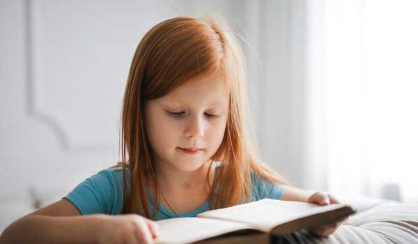 girl-in-blue-t-shirt-reading-book-3755619