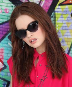 Model wearing Nicole Miller sunglasses