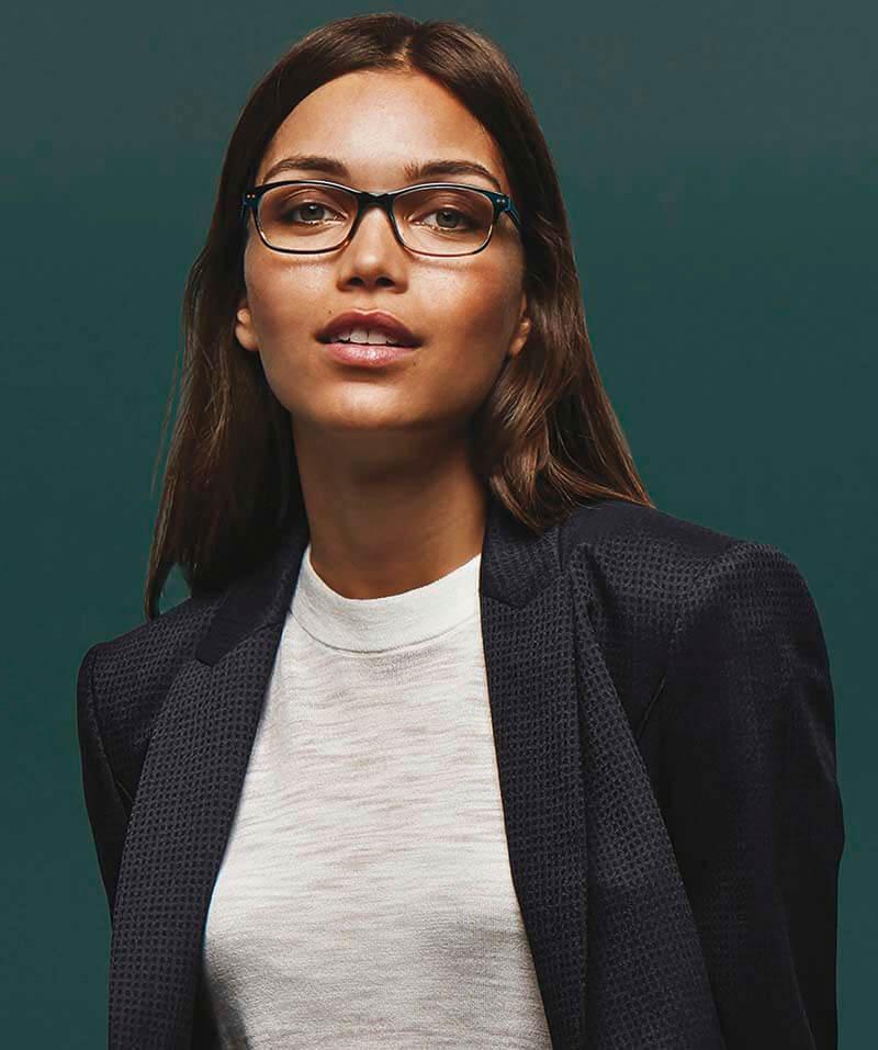 Woman wearing round designer eyeglasses
