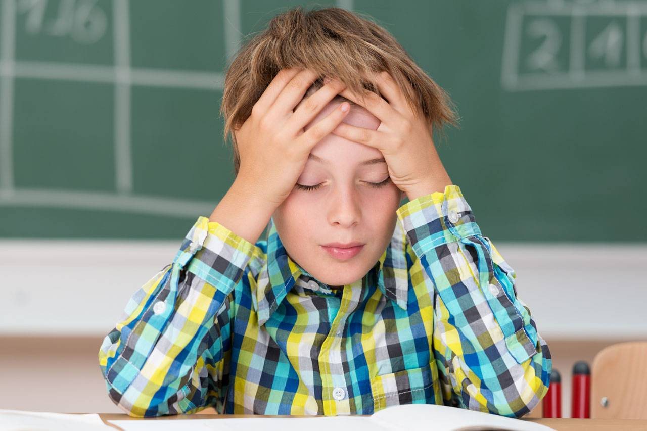 Young Boy Concentrating 1280x853