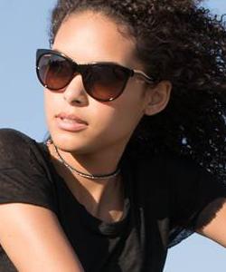 Model wearing Serengeti sunglasses