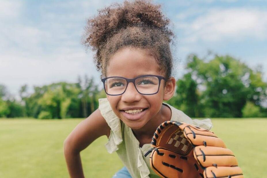 young girl eyeglasses baseball glove