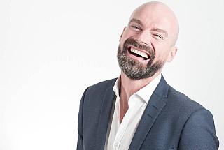man smiling after having LASIK