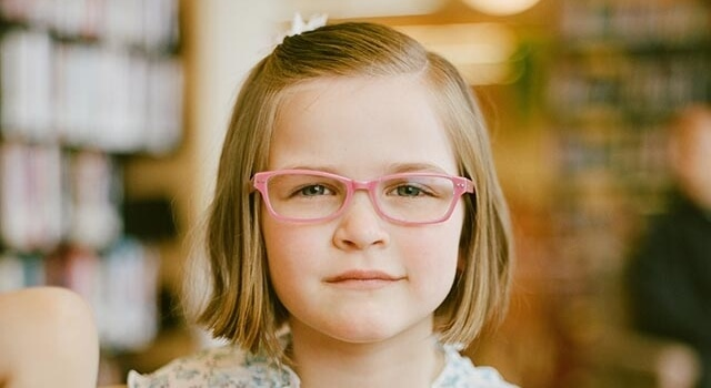 girl wearing pink eyeglasses