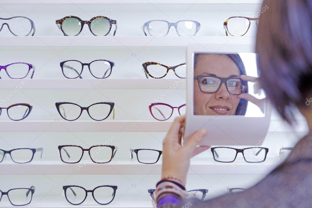 depositphotos_61264409 stock photo trying on glasses with a