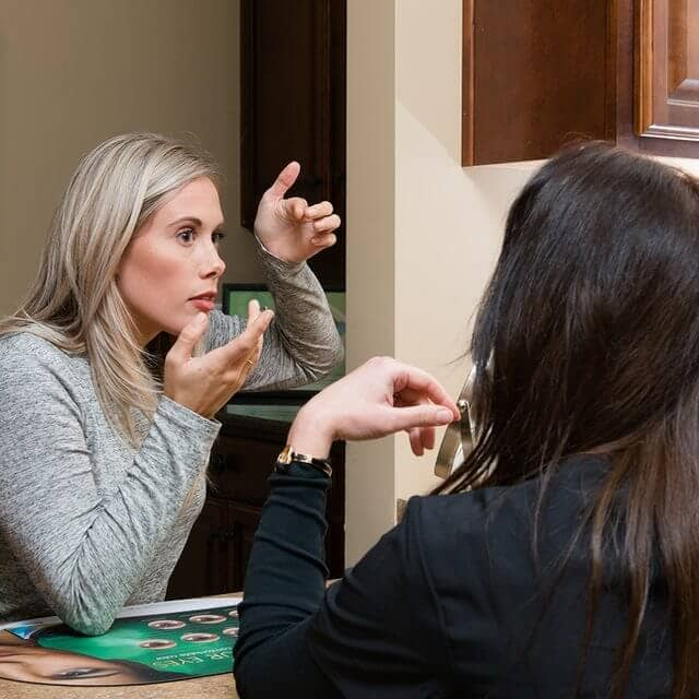 woman putting in contacts optimized