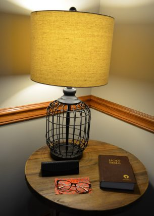 bible and eyeglasses under the lamp