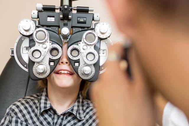 young boy eye exam 640x427