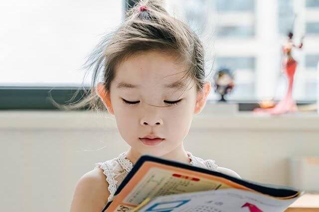 girl reading book 420 640x426